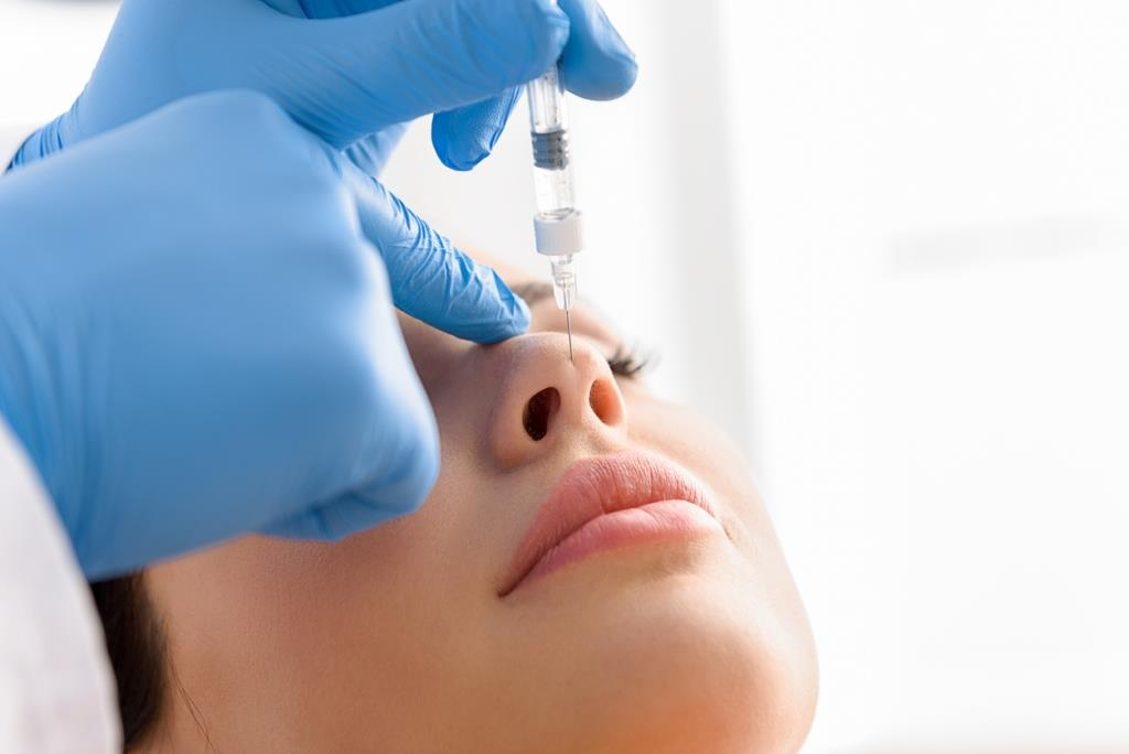 injection in woman face rhinoplasty