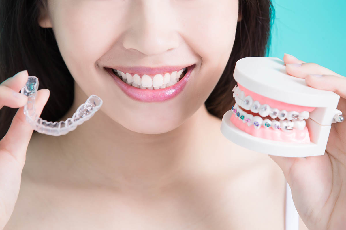 A woman chooses Invisalign or Braces