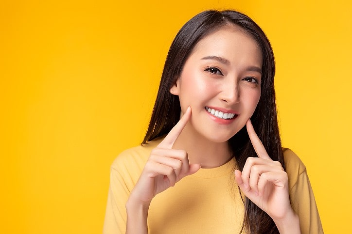 Picture of a lady smiling widely with white teeth
